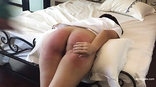 Asian slave Vanida gets a firm painful punishment on her slutty round butt.